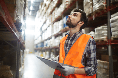 fulfillment operations supervisor looks for inventory in a warehouse