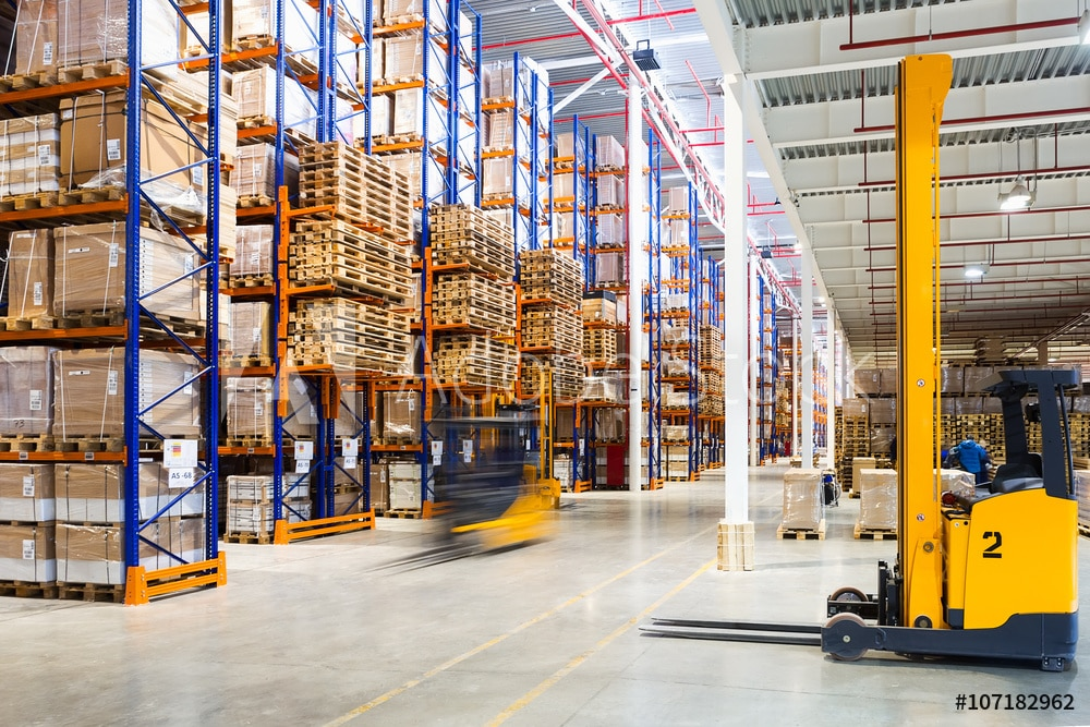 warehouse with forklifts and order picking carts