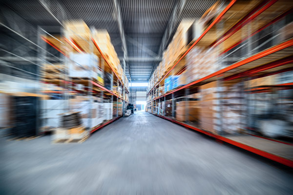 Blurry fast-motion warehouse