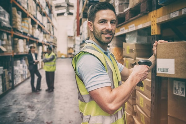 warehouse operator scanning inventory into a warehouse management system