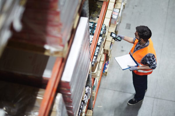 Image of a warehouse operator picking inventory